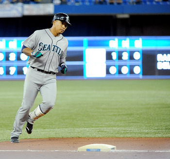 TORONTO, ON - SEPTEMBER 22:  Jose Lopez #4 of the Seattle Mariners rounds third base after hitting his third homerun of the game against the Toronto BLue Jays on September 22, 2010 at the Rogers Centre in Toronto, Canada.  (Photo by Matthew Manor/Getty Im
