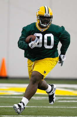 GREEN BAY, WI - MAY 1:  Defensive lineman B.J. Raji #90 runs with the football as he participates in practice drills during Green Bay Packers Minicamp at Don Hutson Center on May 1, 2009 in Green Bay, Wisconsin. (Photo by Scott Boehm/Getty Images)