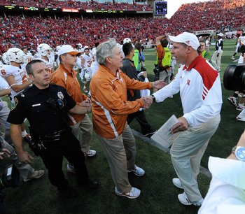 LINCOLN, NE - OCTOBER 16: Coach Mack Brown (left) of the Texas Longhorns shakes hands with Coach Bo Pelini of the Nebraska Cornhuskers after their game at Memorial Stadium on October 16, 2010 in Lincoln, Nebraska. Texas Defeated Nebraska 20-13. (Photo by