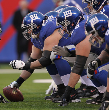 EAST RUTHERFORD, NJ - DECEMBER 19:  Shaun O'Hara #60 of the New York Giants gets ready to snap the ball against  the Philadelphia Eagles during their game on December 19, 2010 at The New Meadowlands Stadium in East Rutherford, New Jersey.  (Photo by Al Be