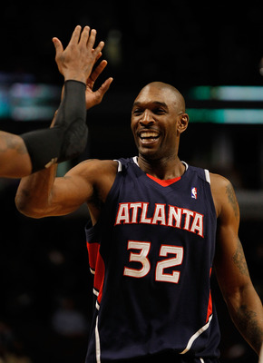 CHICAGO - MARCH 01: Joe Smith #32 of the Atlanta Hawks is congratulated by teammates after a win over the Chicago Bulls at the United Center on March 1, 2010 in Chicago, Illinois. The Hawks defeated the Bulls 116-92. NOTE TO USER: User expressly acknowled