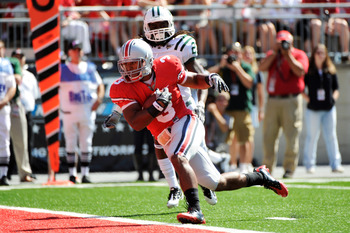COLUMBUS, OH - SEPTEMBER 18:  Brandon Saine #3 of the Ohio State Buckeyes lunges into the endzone after catching a pass against the Ohio Bobcats at Ohio Stadium on September 18, 2010 in Columbus, Ohio.  (Photo by Jamie Sabau/Getty Images)