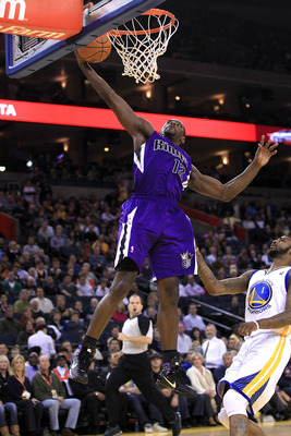 OAKLAND, CA - JANUARY 21:  Tyreke Evans #13 of the Sacramento Kings goes up for a shot over Dorell Wright #1 of the Golden State Warriors at Oracle Arena on January 21, 2011 in Oakland, California. NOTE TO USER: User expressly acknowledges and agrees that