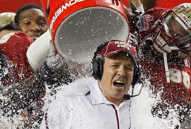 ATLANTA, GA - DECEMBER 31:  Head coach JimboFisher of the Florida State Seminoles is doused with water in the final seconds of their 26-17 win over the South Carolina Gamecocks during the 2010 Chick-fil-A Bowl at Georgia Dome on December 31, 2010 in Atlan
