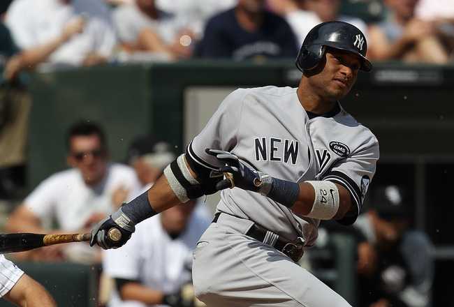 CHICAGO - AUGUST 29: Robinson Cano #24 of the New York Yankees hits the ball against the Chicago White Sox at U.S. Cellular Field on August 29, 2010 in Chicago, Illinois. The Yankees defeated the White Sox 2-1. (Photo by Jonathan Daniel/Getty Images)