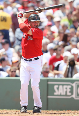 BOSTON - JULY 04:  Kevin Youkilis #20 of the Boston Red Sox waits for his pitch against the Baltimore Orioles on July 4, 2010 at Fenway Park in Boston, Massachusetts.  (Photo by Elsa/Getty Images)