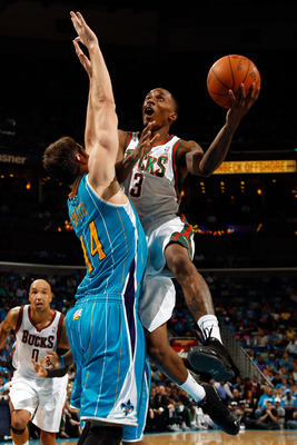 NEW ORLEANS - OCTOBER 27:  Brandon Jennings #3 of the Milwaukee Bucks shoots the ball over Jason Smith #14 of the New Orleans Hornets at the New Orleans Arena on October 27, 2010 in New Orleans, Louisiana.   The Hornets defeated the Bucks 95-91.   NOTE TO