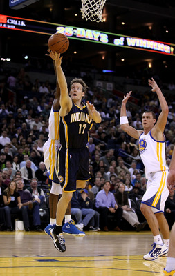 OAKLAND, CA - JANUARY 19:  Mike Dunleavy #17 of the Indiana Pacers goes up for a shot during their game against the Golden State Warriors at Oracle Arena on January 19, 2011 in Oakland, California.  NOTE TO USER: User expressly acknowledges and agrees tha