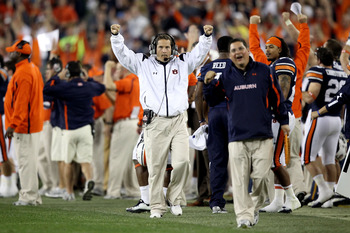 GLENDALE, AZ - JANUARY 10:  Head coach Gene Chizik of the Auburn Tigers reacts after a late fourth-quarter run by Michael Dyer #5 that was ruled he was not down by contact against the Oregon Ducks during the Tostitos BCS National Championship Game at Univ