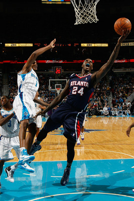 NEW ORLEANS, LA - DECEMBER 26:  Marvin Williams #24 of the Atlanta Hawks shoots the ball over Trevor Ariza #1 of the New Orleans Hornets at the New Orleans Arena on December 26, 2010 in New Orleans, Louisiana.  NOTE TO USER: User expressly acknowledges an