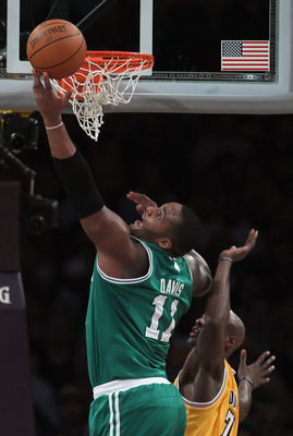 LOS ANGELES, CA - JANUARY 30:  Glen Davis #11 of the Boston Celtics drives to the basket past Lamar Odom #7 of the Los Angeles Lakers in the first half at Staples Center on January 30, 2011 in Los Angeles, California. The Celtics defeated the Lakers 109-9