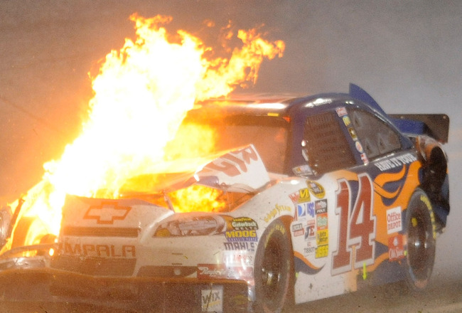 DAYTONA BEACH, FL - JULY 03:  The car of Tony Stewart, driver of the #14 Burger King Chevrolet, is engulfed in flames after crashing during the NASCAR Sprint Cup Series Coke Zero 400 at Daytona International Speedway on July 3, 2010 in Daytona Beach, Flor