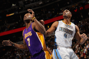 DENVER, CO - JANUARY 21:  Lamar Odom #7 of the Los Angeles Lakers and Arron Afflalo #6 of the Denver Nuggets battle for rebounding position at the Pepsi Center on January 21, 2011 in Denver, Colorado. NOTE TO USER: User expressly acknowledges and agrees t
