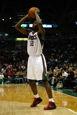MILWAUKEE, WI - JANUARY 07: Luc Richard Mbah a Moute #12 of the Milwaukee Bucks shoots against the Miami Heat at the Bradley Center on January 7, 2011 in Milwaukee, Wisconsin. NOTE TO USER: User expressly acknowledges and agrees that, by downloading and o