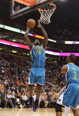 PHOENIX, AZ - JANUARY 30:  Emeka Okafor #50 of the New Orleans Hornets puts up a shot against the Phoenix Suns during the NBA game at US Airways Center on January 30, 2011 in Phoenix, Arizona.  NOTE TO USER: User expressly acknowledges and agrees that, by