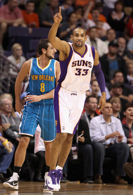PHOENIX, AZ - JANUARY 30:  Grant Hill #33 of the Phoenix Suns reacts after hitting a three point shot past Marco Belinelli #8 of the New Orleans Hornets during the NBA game at US Airways Center on January 30, 2011 in Phoenix, Arizona.  The Suns defeated t