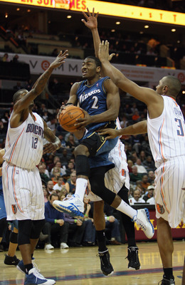 CHARLOTTE, NC - JANUARY 08:  John Wall #1 of the Washington Wizards drives to the basket against the Charlotte Bobcats during their game at Time Warner Cable Arena on January 8, 2011 in Charlotte, North Carolina. NOTE TO USER: User expressly acknowledges