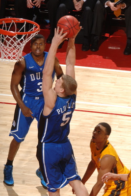 COLLEGE PARK, MD - FEBRUARY 2: Mason Plumlee #5 of the Duke Blue Devils goes for a jam during a college basketball game against the Maryland Terrapins on February 2, 2011 at the Comcast Arena in College Park, Maryland. The Blue Devils won 80-62. (Photo by