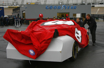 BRISTOL, TN - MARCH 01:  The #8 Budweiser Chevrolet crew pushes their car after rain began to fall during NASCAR Car of Tomorrow testing at Bristol Motor Speedway on March 1, 2007 in Bristol, Tennessee.  (Photo by Rusty Jarrett/Getty Images for NASCAR)