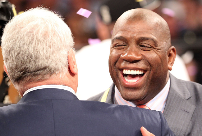 LOS ANGELES, CA - JUNE 17:  Earvin 'Magic' Johnson hugs general manager Mitch Kupchak after the Los Angeles Lakers defeated the Boston Celtics in Game Seven of the 2010 NBA Finals at Staples Center on June 17, 2010 in Los Angeles, California.  NOTE TO USE