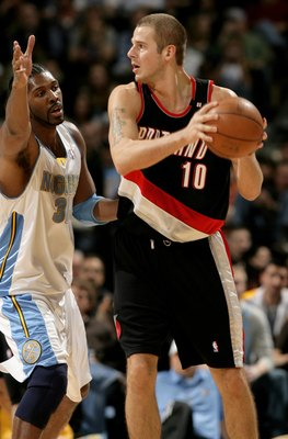 DENVER - MARCH 05:  Joel Przybilla #10 of the Portland Trail Blazers controls the ball against the defense of Nene #31 of the Denver Nuggets during NBA action at the Pepsi Center on March 5, 2009 in Denver, Colorado. The Nuggets defeated the Trail Blazers