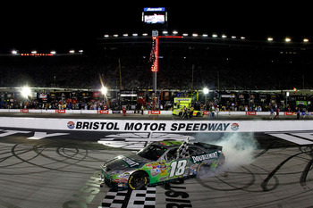 BRISTOL, TN - AUGUST 21:  Kyle Busch, driver of the #18 Doublemint Toyota, burns out after winning the NASCAR Sprint Cup Series IRWIN Tools Night Race at Bristol Motor Speedway on August 21, 2010 in Bristol, Tennessee.  (Photo by Jason Smith/Getty Images)