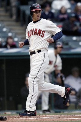 CLEVELAND - APRIL 17:  Grady Sizemore #24 of the Cleveland Indians crosses home plate after scoring in the first inning against the Chicago White Sox during the game on April 17, 2010 at Progressive Field in Cleveland, Ohio.  (Photo by Jared Wickerham/Get