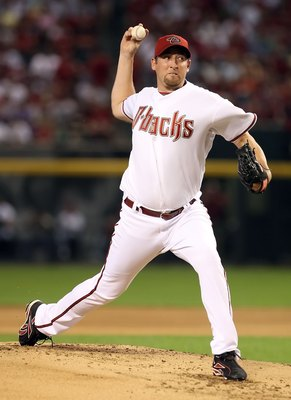 PHOENIX - APRIL 06:  Starting pitcher Brandon Webb #17 of the Arizona Diamondbacks pitches against the Colorado Rockies during the MLB openning day game at Chase Field on April 6, 2009 in Phoenix, Arizona.  The Diamondbacks defeated the Rockies 9-8.  (Pho
