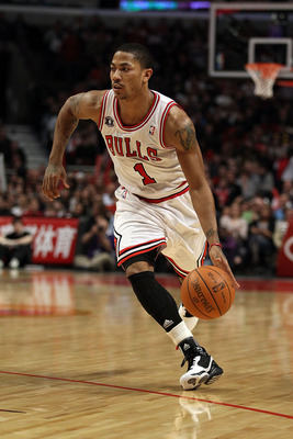 CHICAGO, IL - JANUARY 28: Derrick Rose #1 of the Chicago Bulls drives against the Orlando Magic at the United Center on January 28, 2011 in Chicago, Illinois. The Bulls defeated the Magic 99-90. NOTE TO USER: User expressly acknowledges and agrees that, b