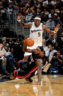 WASHINGTON - DECEMBER 18:  LeBron James #6 of the Miami Heat is fouled by Josh Howard #5 of the Washington Wizards at the Verizon Center on December 18, 2010 in Washington, DC. NOTE TO USER: User expressly acknowledges and agrees that, by downloading and