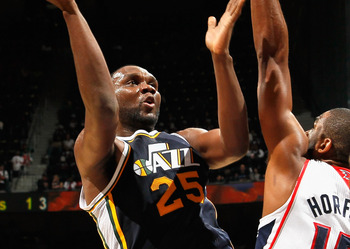 ATLANTA - NOVEMBER 12:  Al Jefferson #25 of the Utah Jazz against Al Horford #15 of the Atlanta Hawks at Philips Arena on November 12, 2010 in Atlanta, Georgia.  NOTE TO USER: User expressly acknowledges and agrees that, by downloading and/or using this P