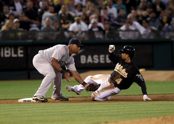 OAKLAND, CA - SEPTEMBER 10:  Coco Crisp #4 of the Oakland Athletics is tagged out by Adrian Beltre #29 of the Boston Red Sox after Crisp tried to reach third base after tagging up on a fly out to center field at the Oakland-Alameda County Coliseum on Sept