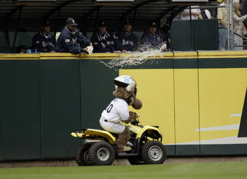 SEATTLE - SEPTEMBER 14:  The Mariner Moose is doused with water by members of the Mariners' bullpen between innings of the game against the Anaheim Angels on September 14, 2003 at Safeco Field in Seattle, Washington.  The Angels defeated the Mariners 2-1.