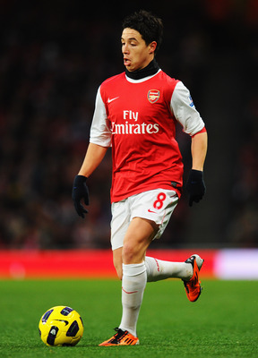 LONDON, UNITED KINGDOM - JANUARY 22:  Samir Nasri of Arsenal runs with the ball during the Barclays Premier League match between Arsenal and Wigan Athletic at the Emirates Stadium on January 22, 2011 in London, England.  (Photo by Mike Hewitt/Getty Images