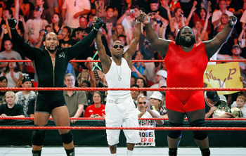LAS VEGAS - AUGUST 24:  (L-R) Wrestler MVP, boxer Floyd Mayweather Jr. and wrestler Mark Henry celebrate at the end of a tag team match during the WWE Monday Night Raw show at the Thomas & Mack Center August 24, 2009 in Las Vegas, Nevada. Mayweather was a