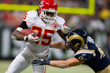 19: Jamaal Charles #25 of the Kansas City Chiefs looks to get by Craig
