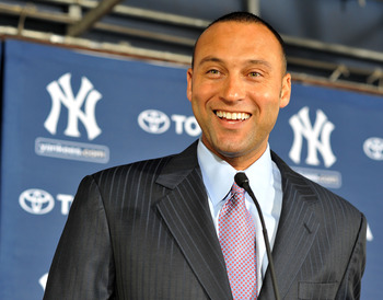 TAMPA, FL - DECEMBER 07:   Shortstop Derek Jeter of the New York Yankees talks to the media during a press conference to announce his new contract with the club on December 7, 2010 in Tampa, Florida.  (Photo by Tim Boyles/Getty Images)