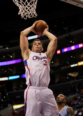 LOS ANGELES, CA - JANUARY 05:  Blake Griffin #32 of the Los Angeles Clippers grabs a rebound against the Denver Nuggets at Staples Center on January 5, 2011  in Los Angeles, California. The Clippers won 106-93.  NOTE TO USER: User expressly acknowledges a