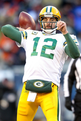 CHICAGO, IL - JANUARY 23:  Quarterback Aaron Rodgers #12 of the Green Bay Packers throws a pass in the third quarter against Chicago Bears in the NFC Championship Game at Soldier Field on January 23, 2011 in Chicago, Illinois.  (Photo by Andy Lyons/Getty