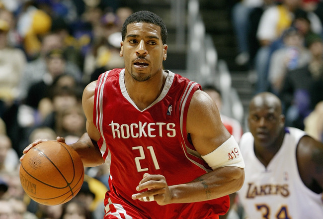 LOS ANGELES - DECEMBER 25:  Jim Jackson #21 of the Houston Rockets moves the ball up court during the game against the Los Angeles Lakers on December 25, 2003 at the Staples Center in Los Angeles, California.  The Rockets won 99-87.  NOTE TO USER: User ex