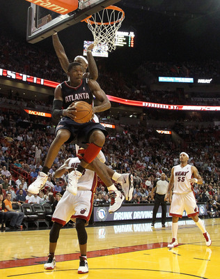 MIAMI, FL - JANUARY 18:  Joe Johnson #2 of the Atlanta Hawks passes out of traffic during a game against the Miami Heat at American Airlines Arena on January 18, 2011 in Miami, Florida. NOTE TO USER: User expressly acknowledges and agrees that, by downloa