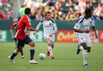 CARSON, CA - OCTOBER 03:  David Beckham #23 of the Los Angeles Galaxy plays the ball through midfield on the counterattack against Chivas USA during the MLS match at The Home Depot Center on October 3, 2010 in Carson, California. The Galaxy defeated Chiva