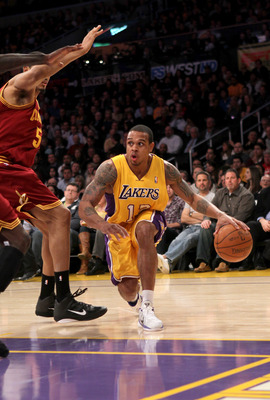 LOS ANGELES, CA - JANUARY 11:  Shannon Brown #12 of the Los Angeles Lakers drives against the Cleveland Cavaliers at Staples Center on January 11, 2011 in Los Angeles, California.  The Lakers won 112-57.  NOTE TO USER: User expressly acknowledges and agre