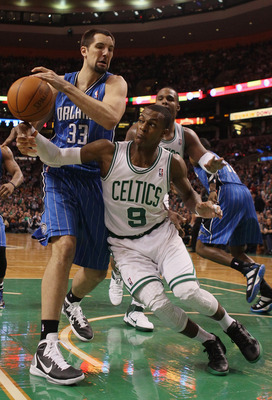 BOSTON, MA - FEBRUARY 06:  Rajon Rondo #9 of the Boston Celtics and Ryan Anderson #33 of the Orlando Magic fight for the ball on February 6, 2011 at the TD Garden in Boston, Massachusetts. The Celtics defeated the Magic 91-80. NOTE TO USER: User expressly
