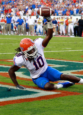 JACKSONVILLE, FL - OCTOBER 30:  Will Hill #10 of the Florida Gators holds up the ball after an interception during the game against the Georgia Bulldogs at EverBank Field on October 30, 2010 in Jacksonville, Florida.  (Photo by Sam Greenwood/Getty Images)
