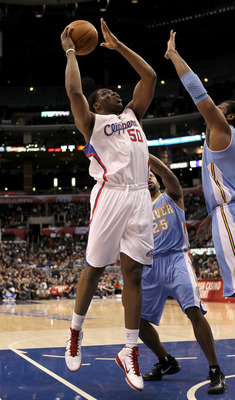 LOS ANGELES, CA - JANUARY 5:  Ike Diogu #50 of the Los Angeles Clippers shoots against the Denver Nuggets at Staples Center on January 5, 2011  in Los Angeles, California. The Clippers won 106-93.  NOTE TO USER: User expressly acknowledges and agrees that