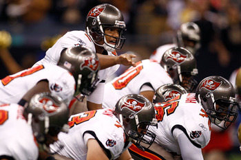 Josh Freeman shows awareness and leadership guiding his team at the line of scrimmage