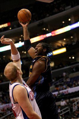 LOS ANGELES, CA - NOVEMBER 20:  Nene #31 of the Denver Nuggets shoots over Chris Kaman #35 of the Los Angeles Clippers on November 20, 2009 at Staples Center in Los Angeles, California.     NOTE TO USER: User expressly acknowledges and agrees that, by dow