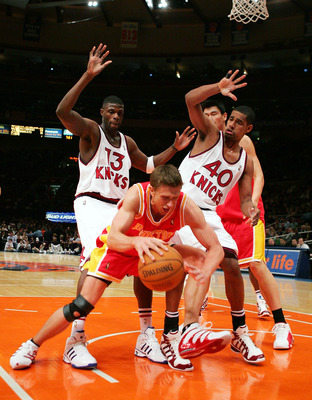 NEW YORK - JANUARY 21:  Nazr Mohammed #13 and Kurt Thomas #40 of the New York Knicks surround Bob Sura #3 of the Houston Rockets on January 21, 2005 at Madison Square Garden in New York City. NOTE TO USER: User expressly acknowledges and agrees that, by d
