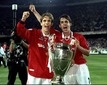 26 May 1999:  Brothers Phillip and Gary Neville of Manchester United with the European Cup after United beat Bayern Munich in the European Champions League Final in the Nou Camp Stadium, Barcelona, Spain. Manchester United won 2 - 1 with both United goals
